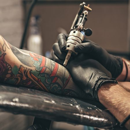 Pimples on a Tattoo? Here's How to Deal With It