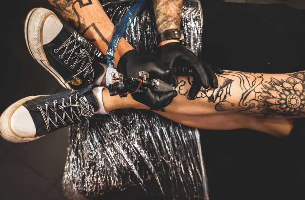 legs being tattooed