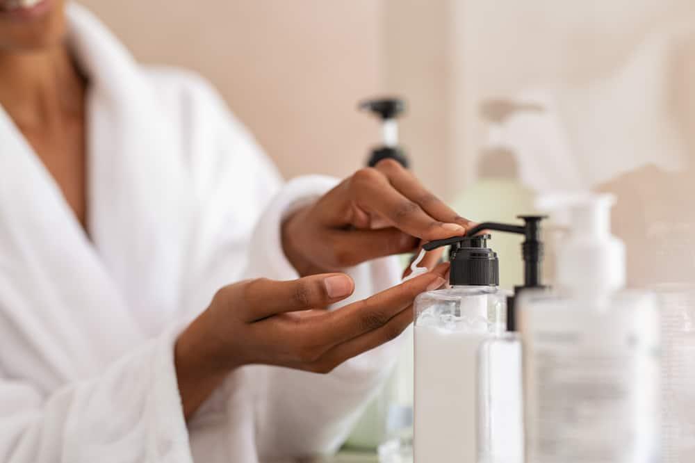 woman dispensing skin cream