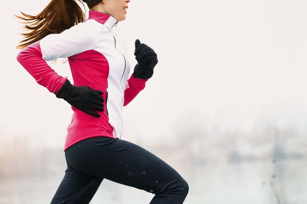woman running in fleece-lined leggings
