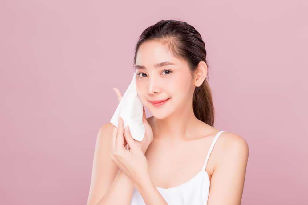 woman using makeup wipe