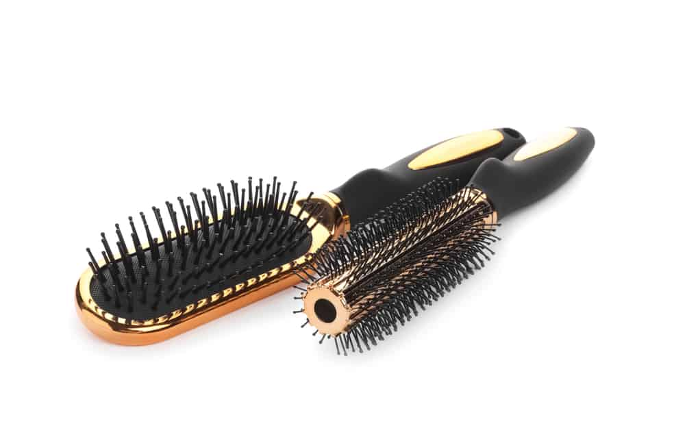 A round hairbrush and a paddle hairbrush