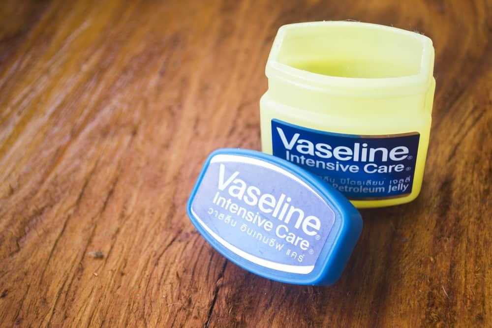 open jar of Vaseline on a wooden table