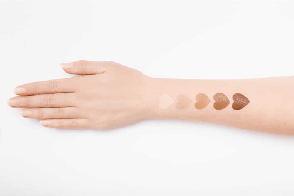 heart-shaped makeup swatches on arm