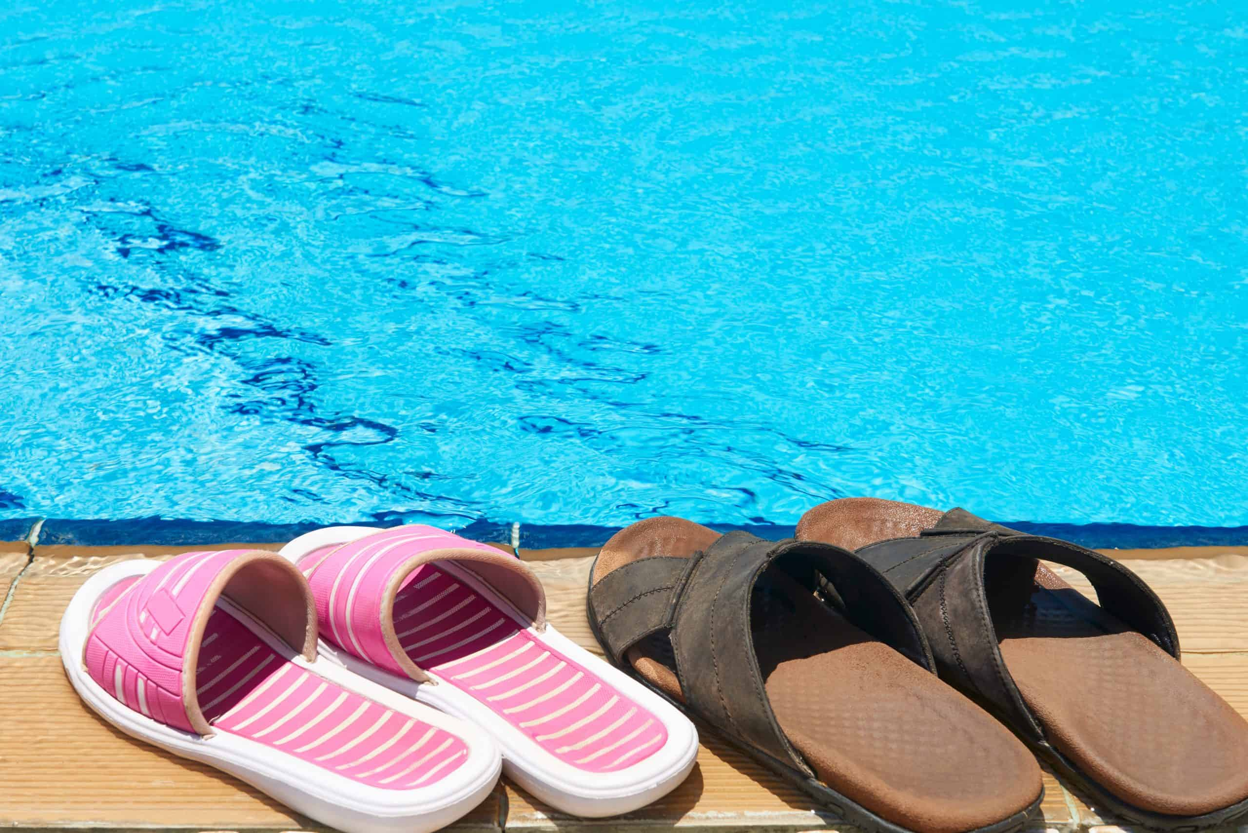 slides shoes by the pool