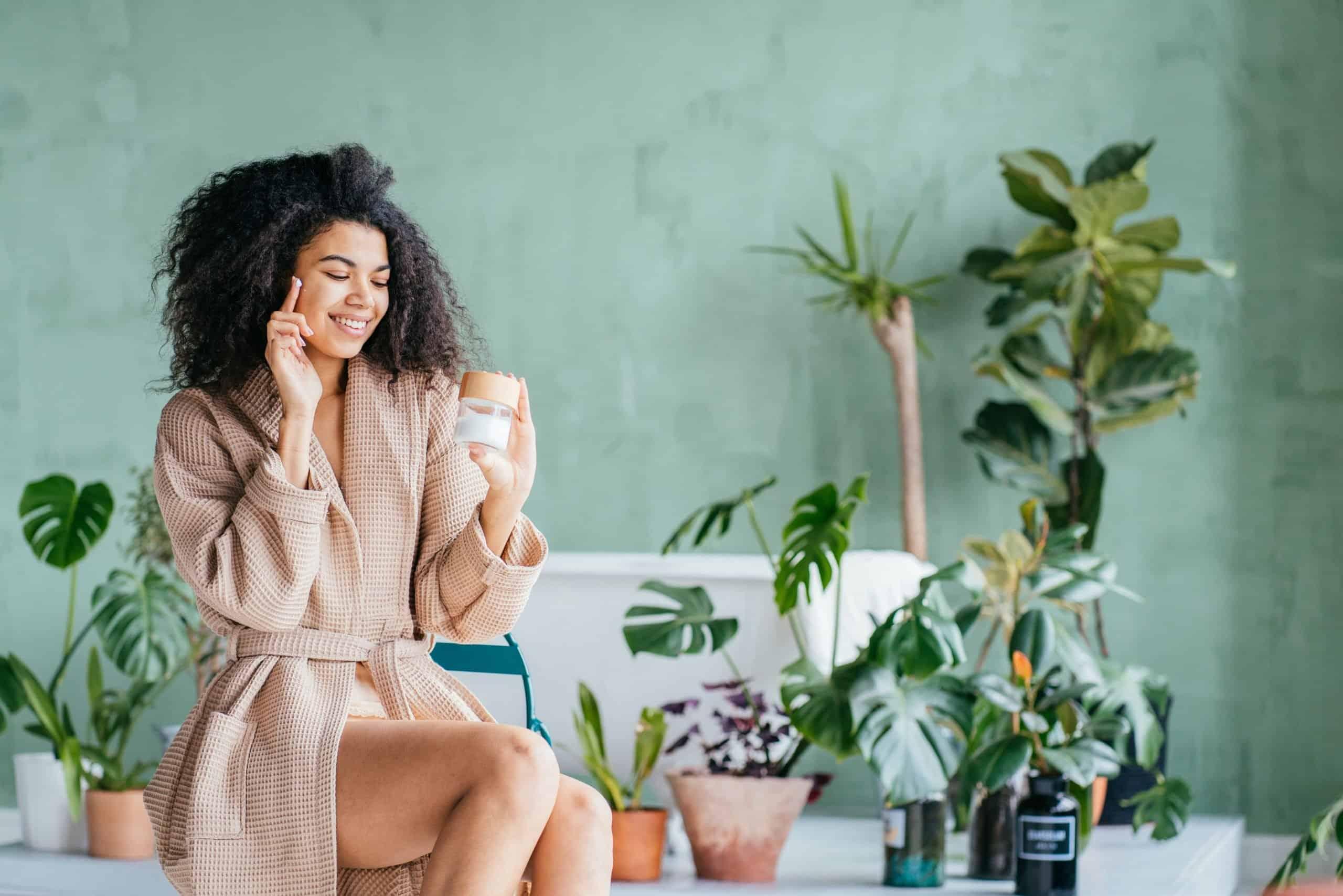 smiling woman enjoying skin care