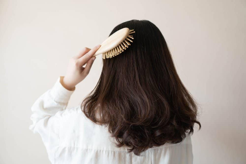 woman brushing black hair