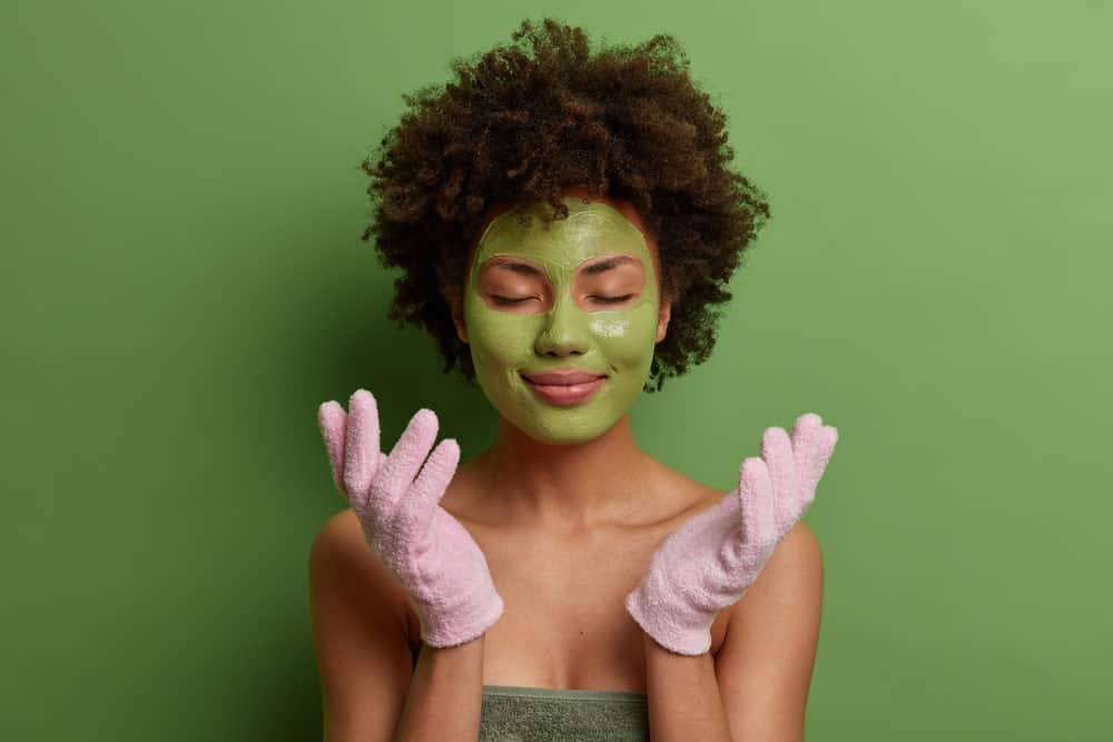 woman exfoliating with gloves
