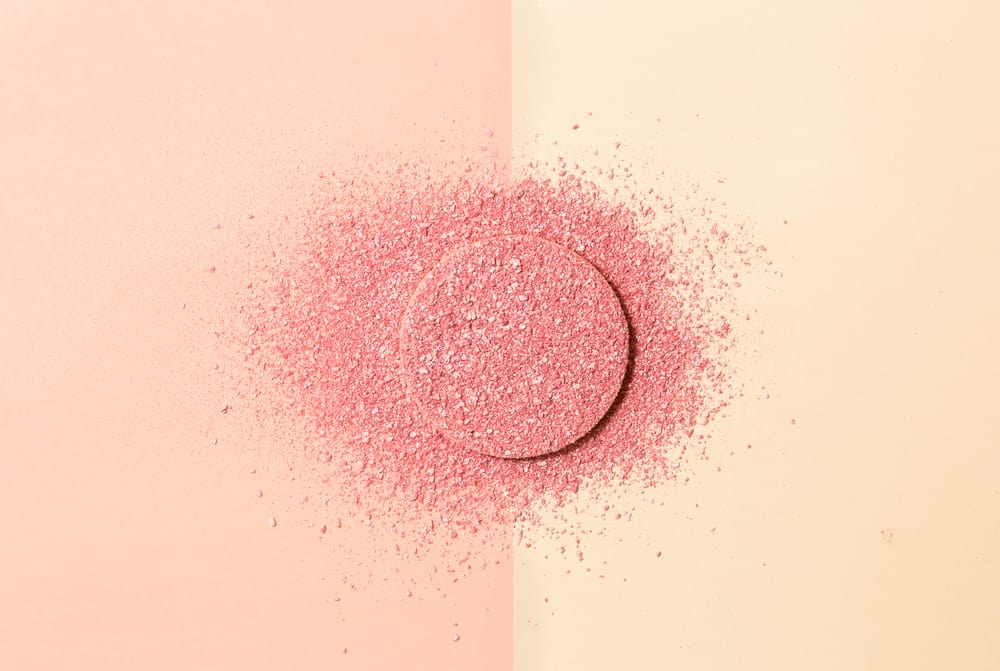 powdered blush on a sponge