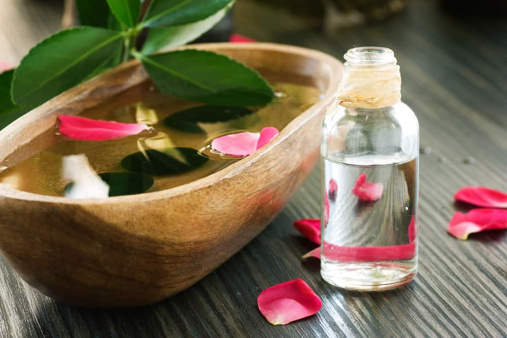 Natural spa scene with rose water