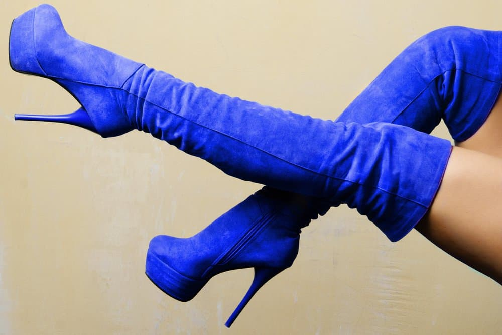 someone wearing blue suede platform boots