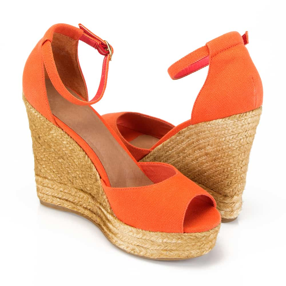 orange espadrille wedges on a white background