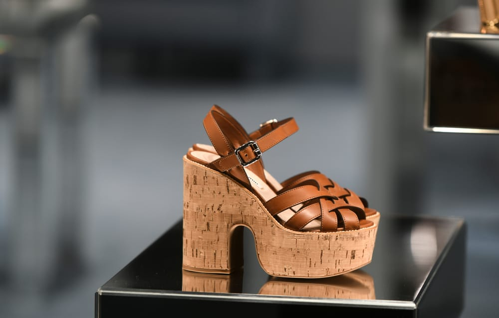 brown cork sandals on a dark grey background