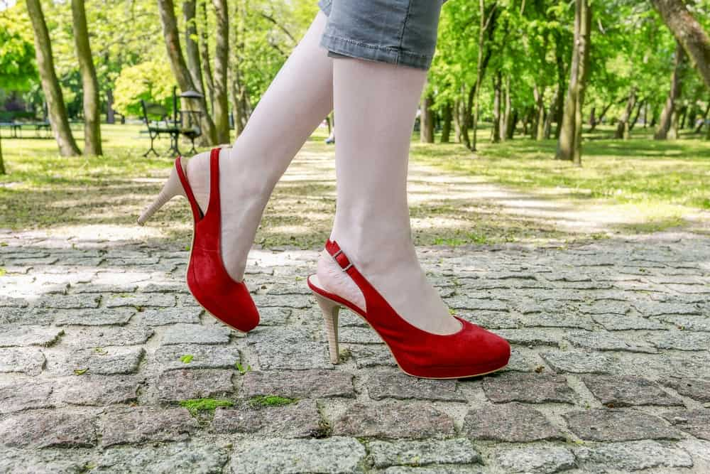 someone wearing red slingback heels