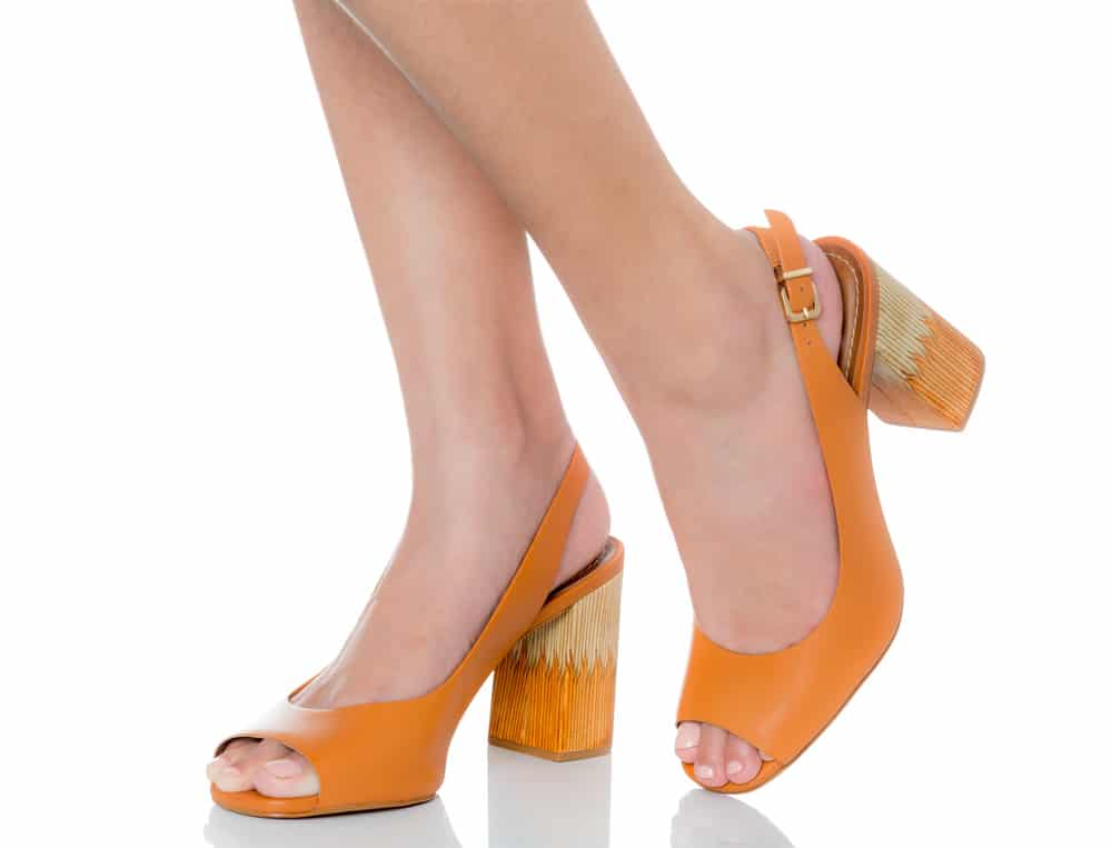woman wearing orange slingback block heels