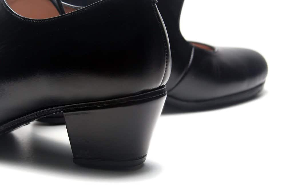 black shiny flamenco shoes on a white background