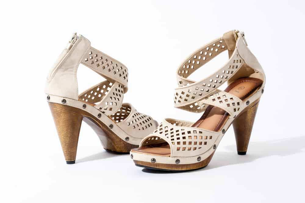 tan cone heeled sandals on a white background