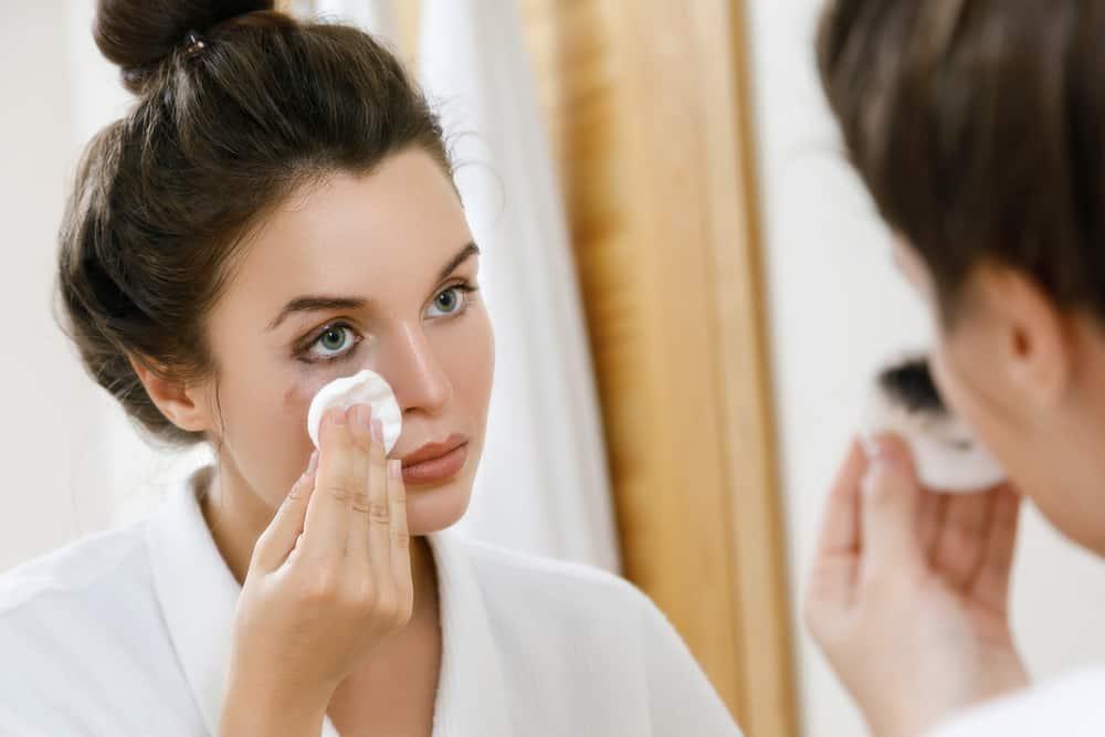 woman removing eyeliner