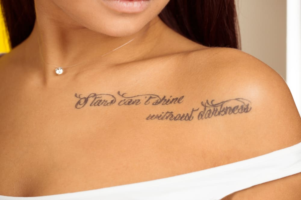 woman with lettering tattoo