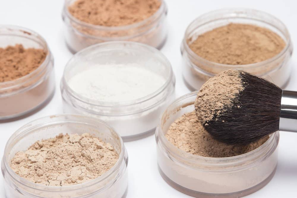 open jars of translucent powder