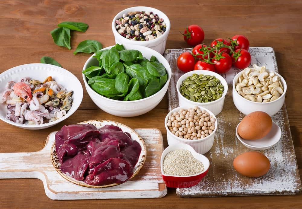 iron-rich foods including nuts, legumes, meat, and vegetables