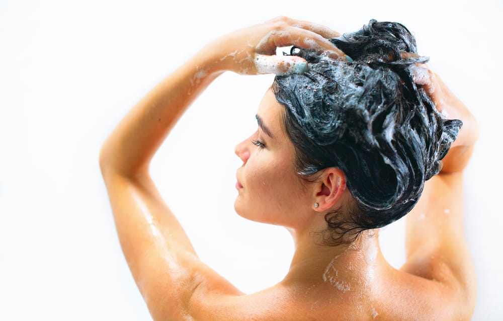 woman moisturizing hair