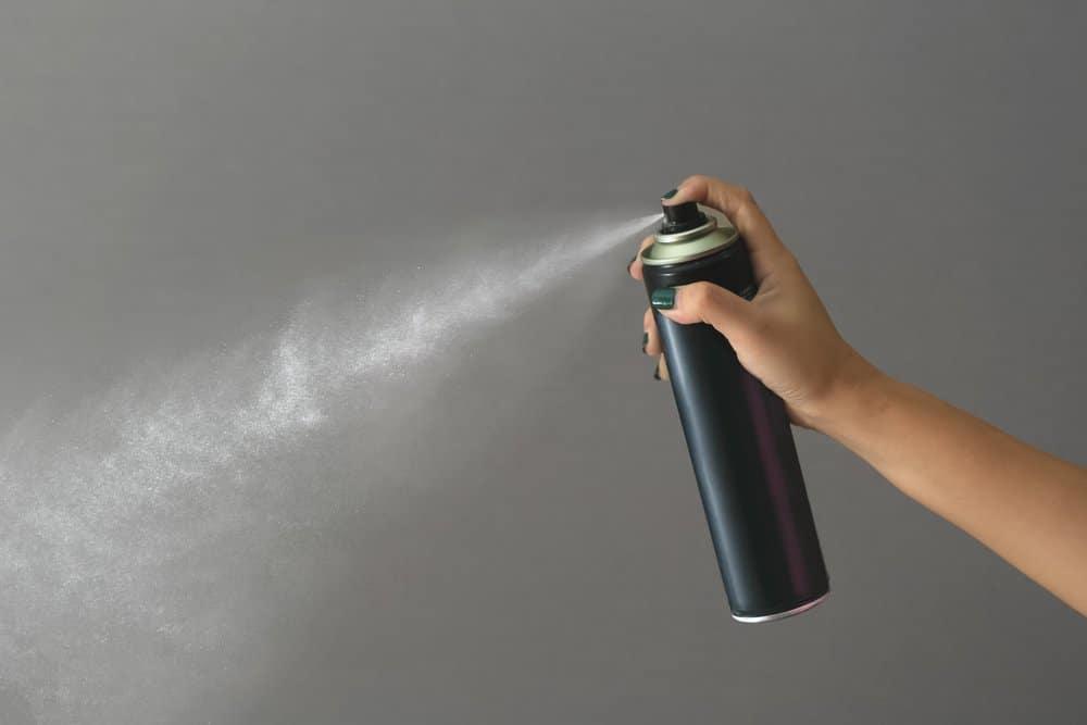 aerosol hairspray on gray background