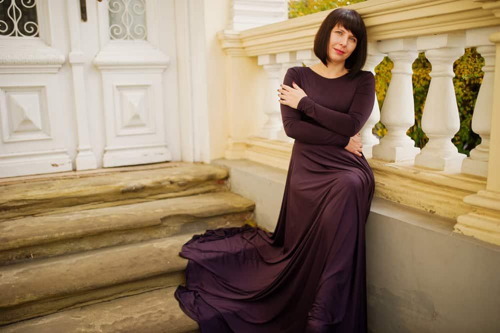 woman in dark purple dress