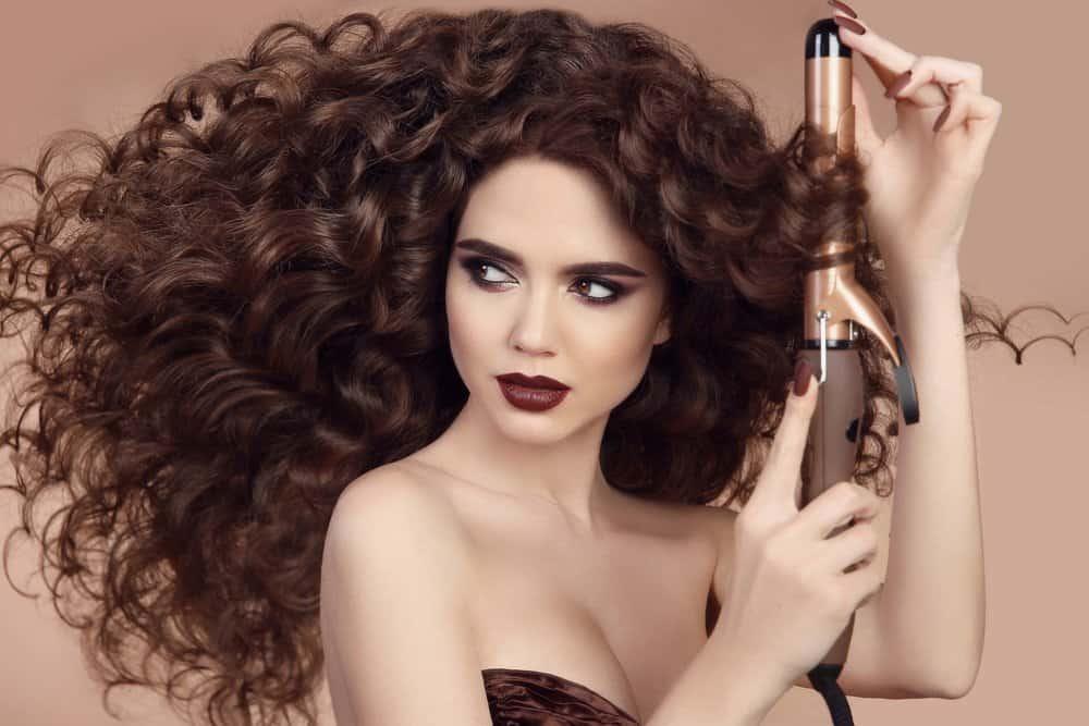 woman curling fine hair