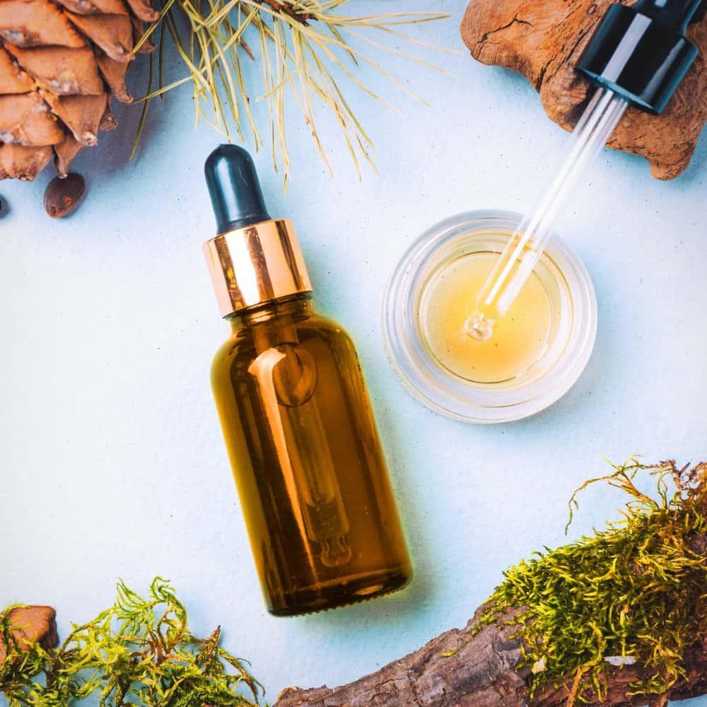 hair oil bottle near ingredients