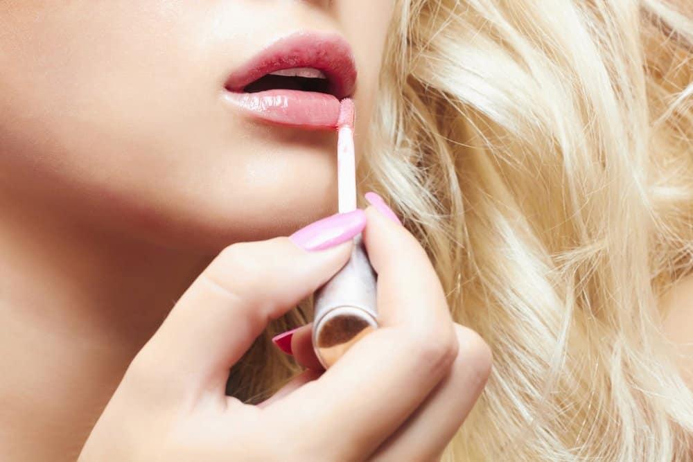 lip gloss applicator on lips