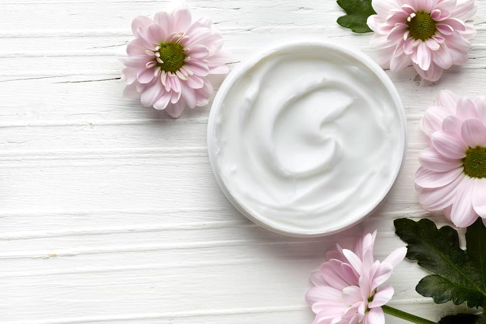 cosmetic cream on table