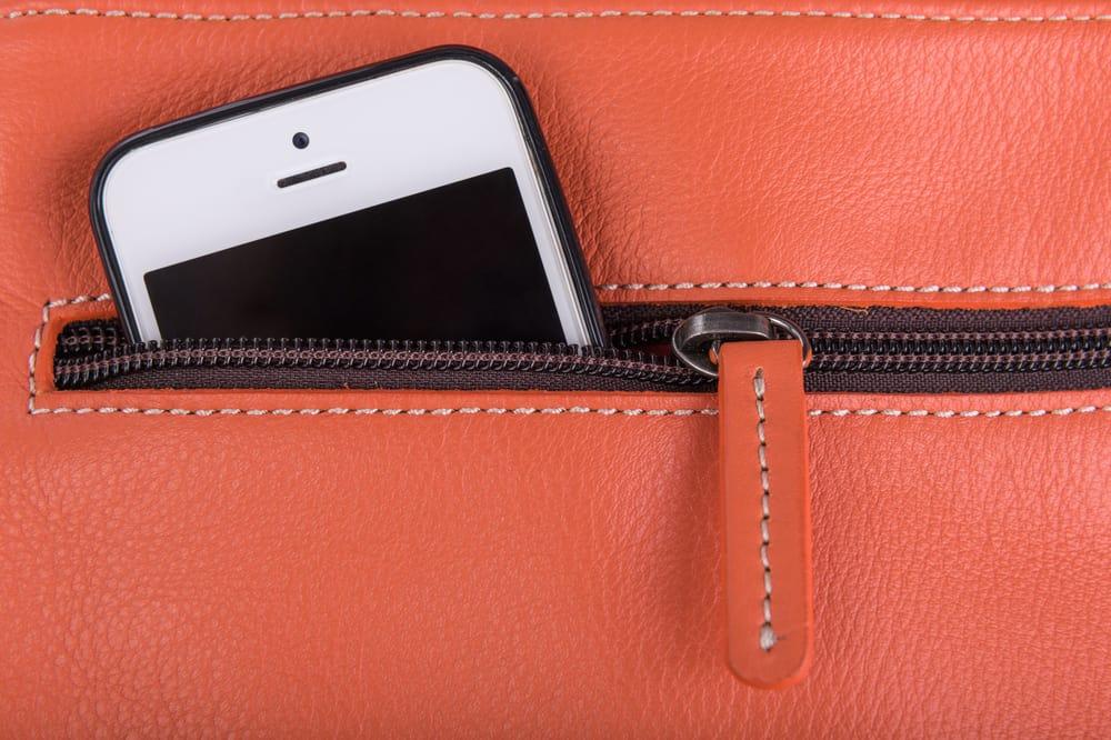 mobile phone in bag pocket