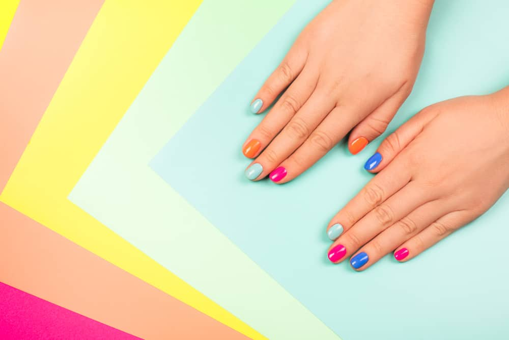 hands with bright manicure