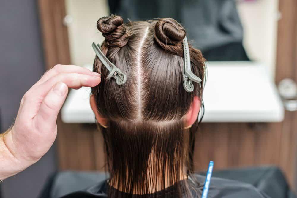 hairdresser sectioning hair