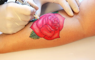 The History and Meaning of the Rose Tattoo