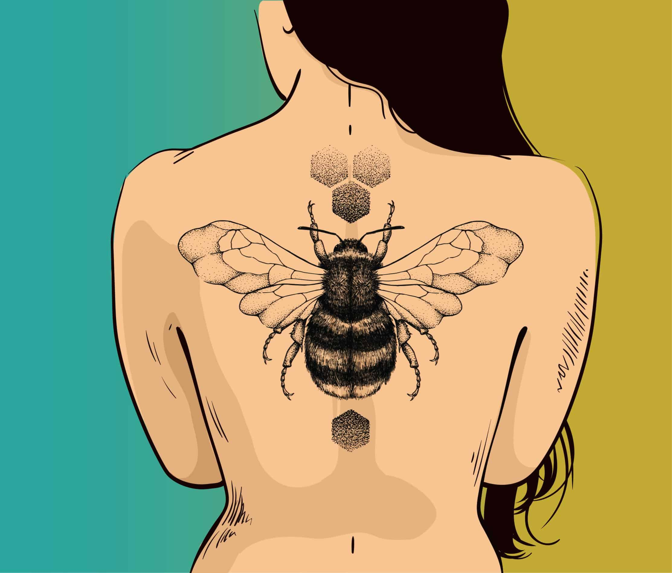 bee tattoo on woman's back