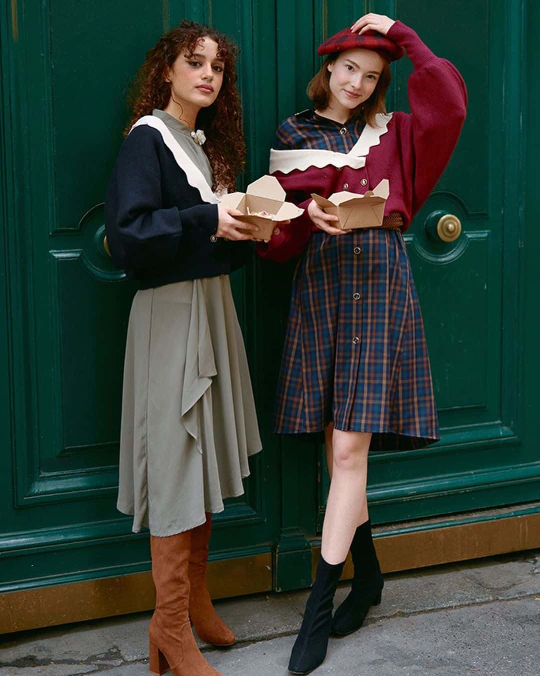 Two models in vintage outfits on a bench