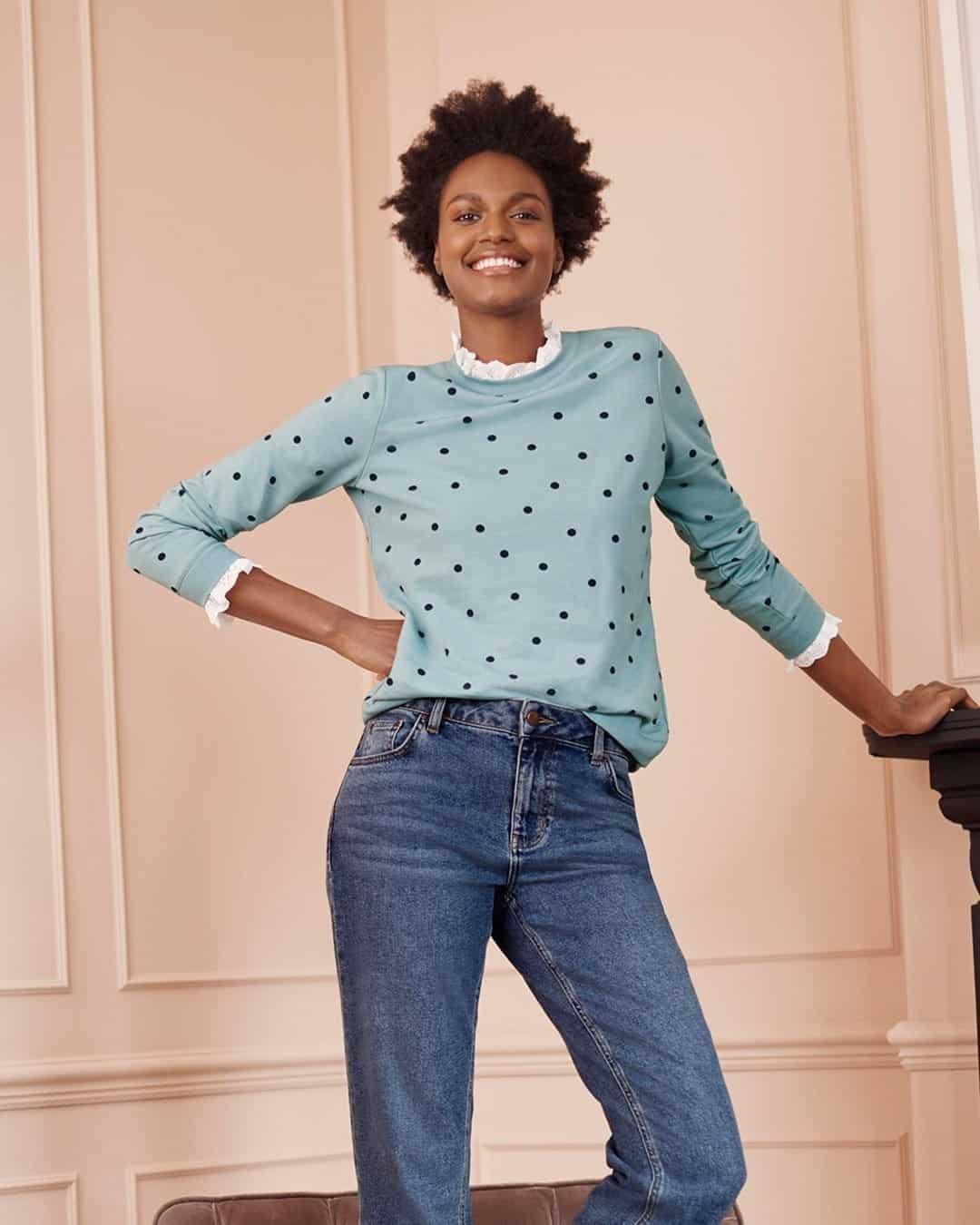Woman in polka dot sweatshirt