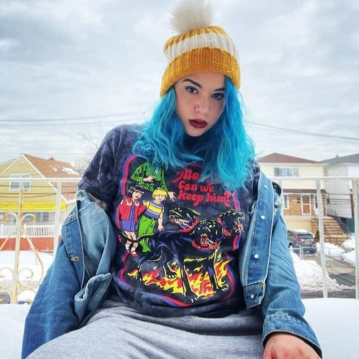 Woman with blue hair in graphic tee-shirt