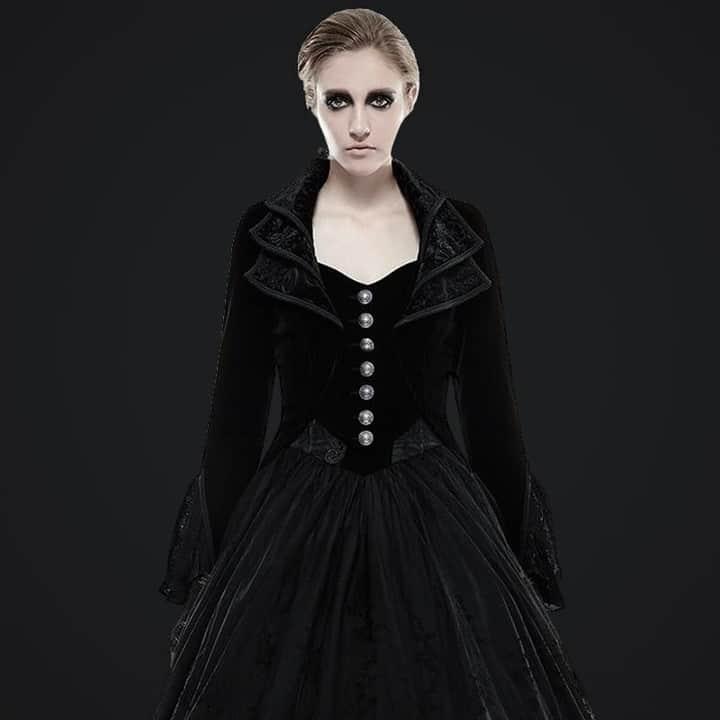 Woman with dark makeup in velvet dress