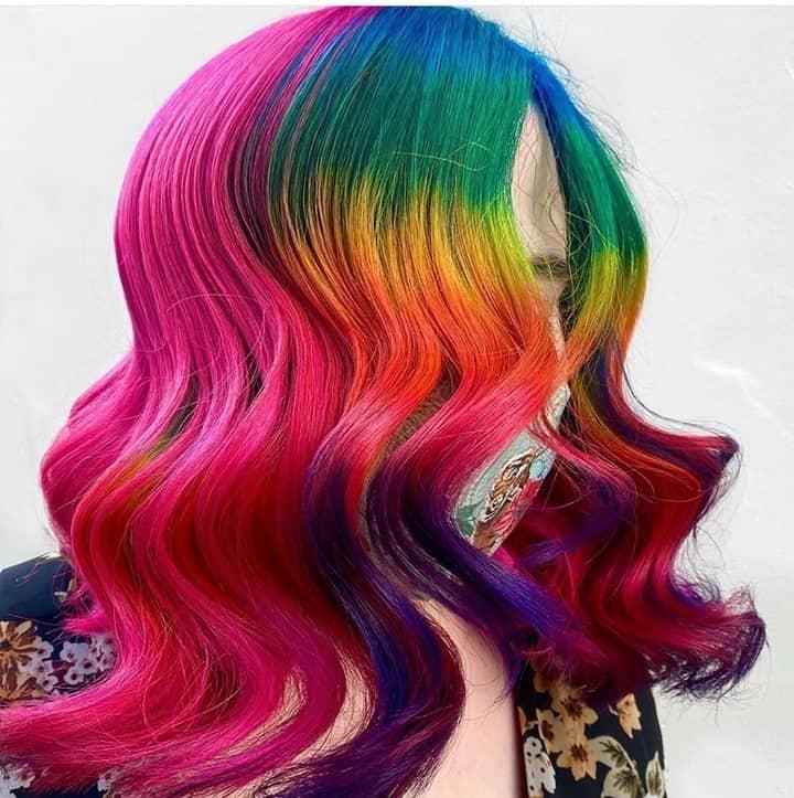 Woman with rainbow hair dye gradient