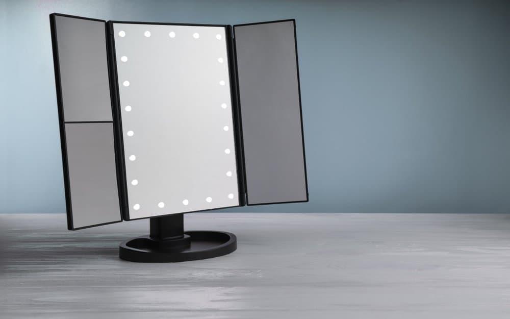 a black unfolded tri-fold mirror