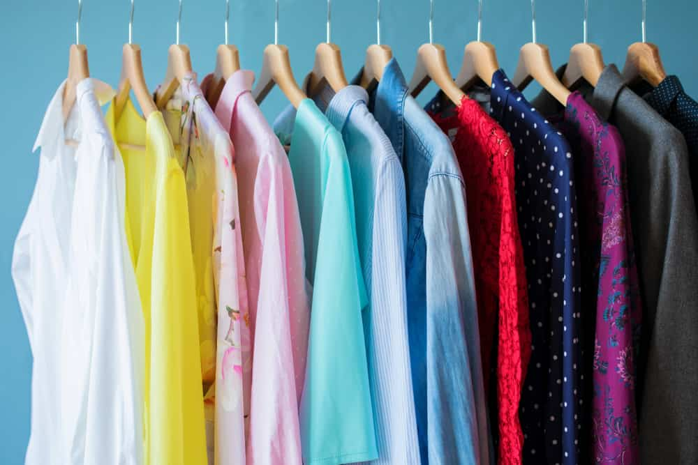 colorful blouses hanging on a rack