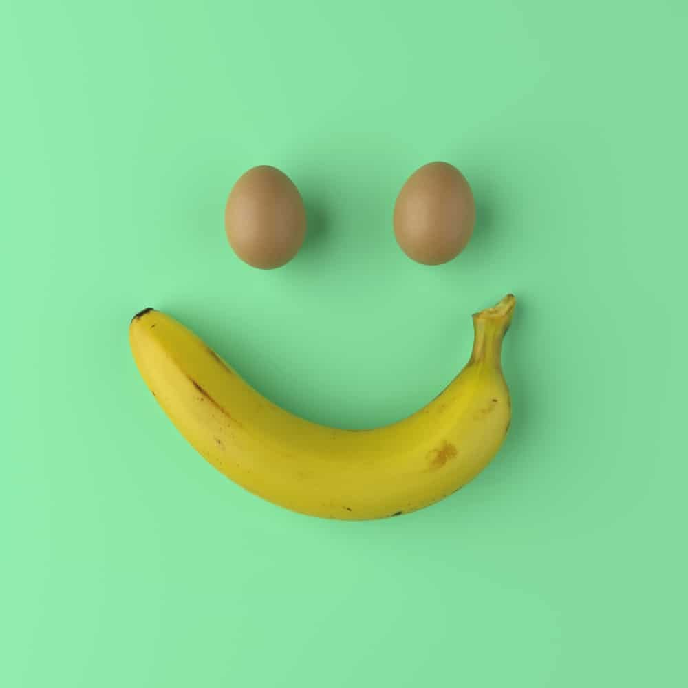 eggs and banana forming smiley face