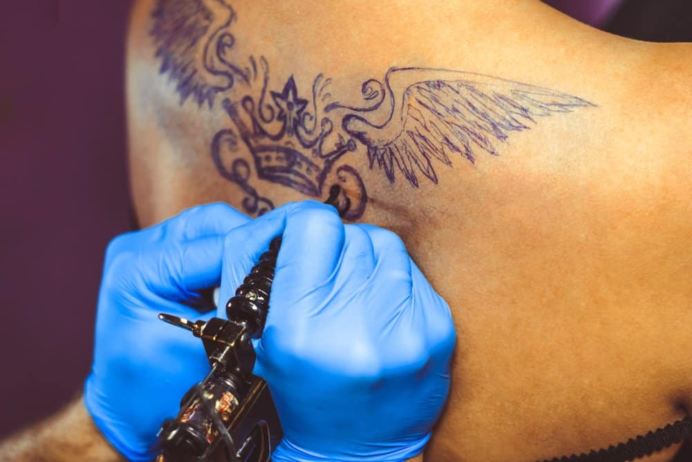 getting crown tattoo with wings