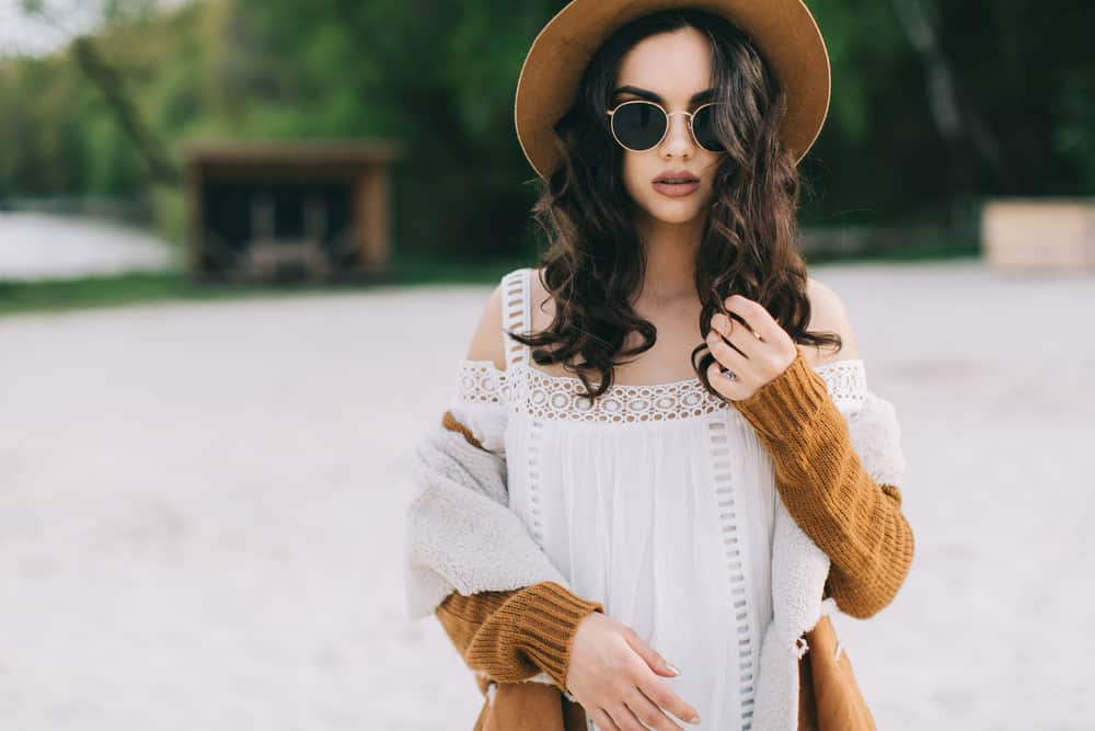 hippie girl in sunglasses and hat