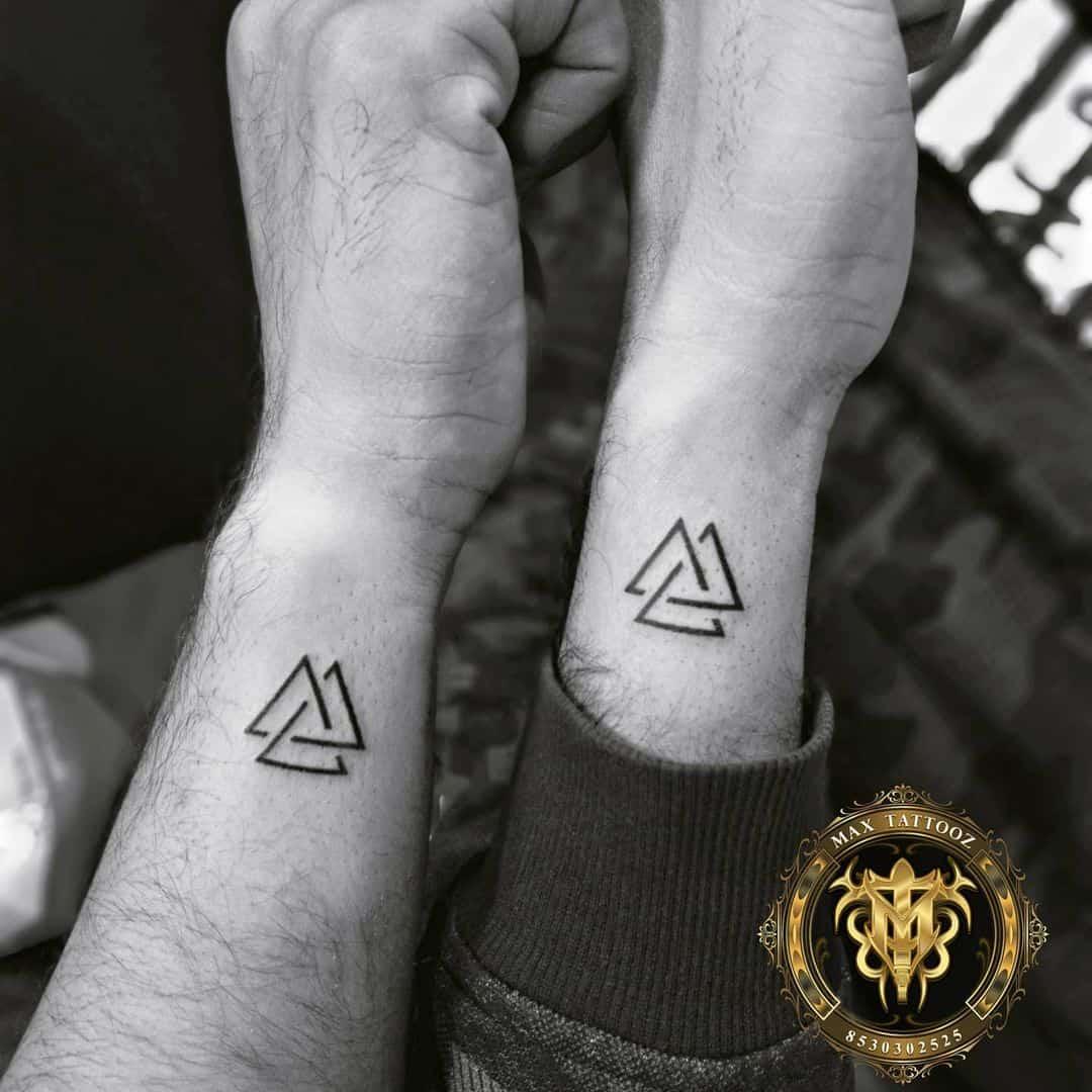 matching triangle tattoos