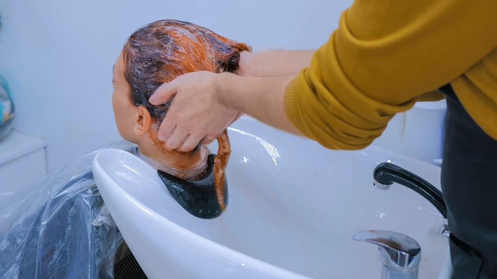 stylist treating orange hair