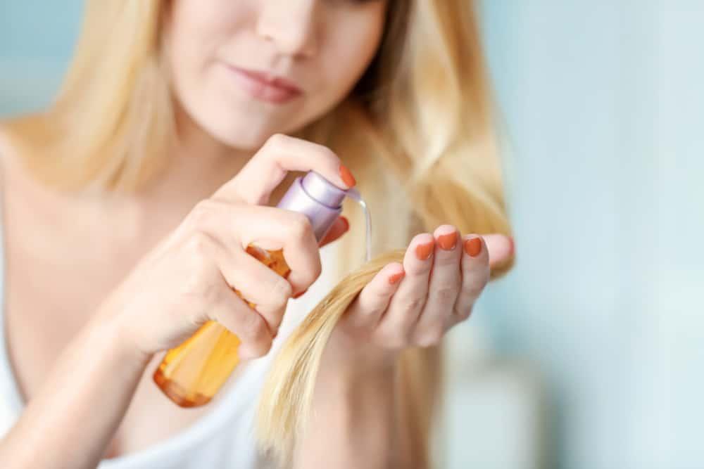 woman using hair treatment